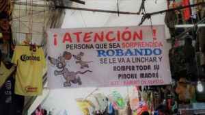 A sign in Tepito market warning criminals about stealing